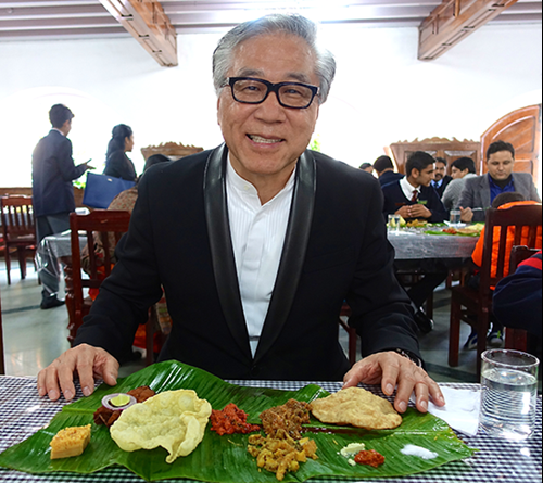 Sun enjoys a traditional banana leaf lunch.